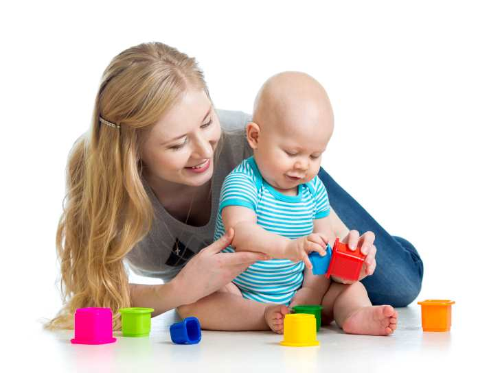 kid boy and mother playing together with cup toys Google